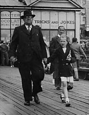 photograph: Charlie Dumville (b 1890) and his granddaughter Carole, Blackpool Pier 1952