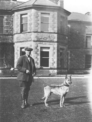 Tommy Thompson the Gamekeeper and Patou in front of Redburn House